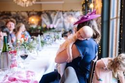 baby sleeping at a wedding